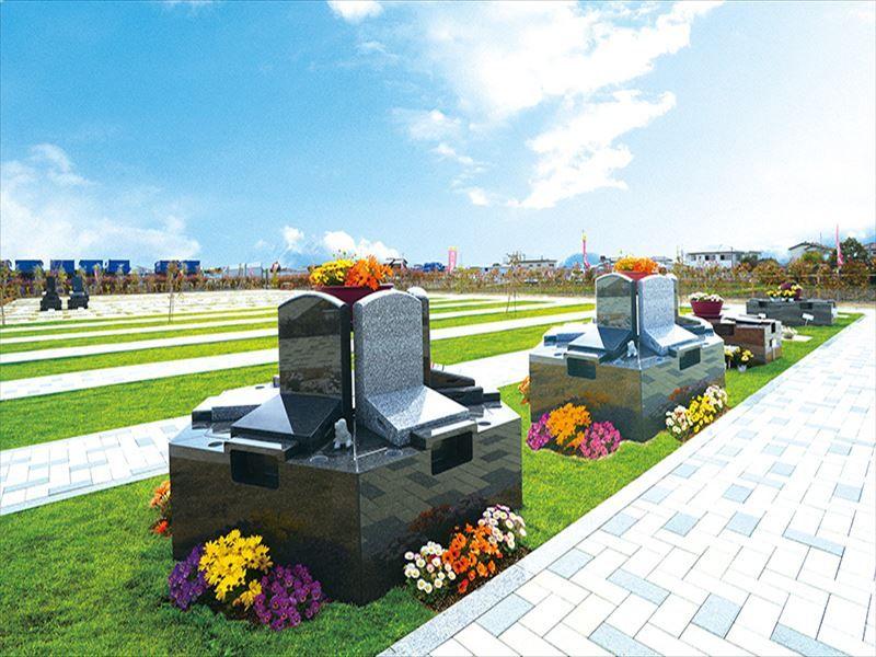 吉川霊園 色とりどりの花が添えられた明るい墓域