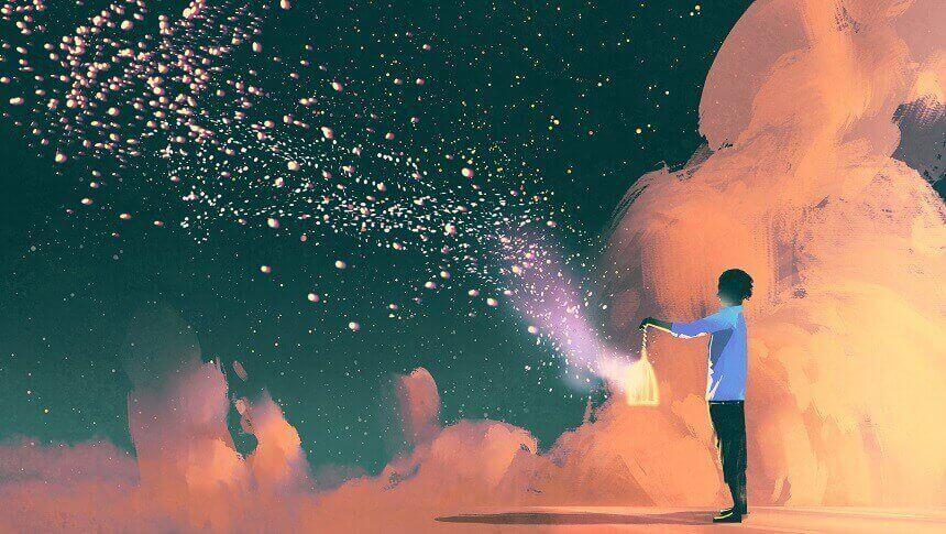 雲の上で灯りを手にする男性